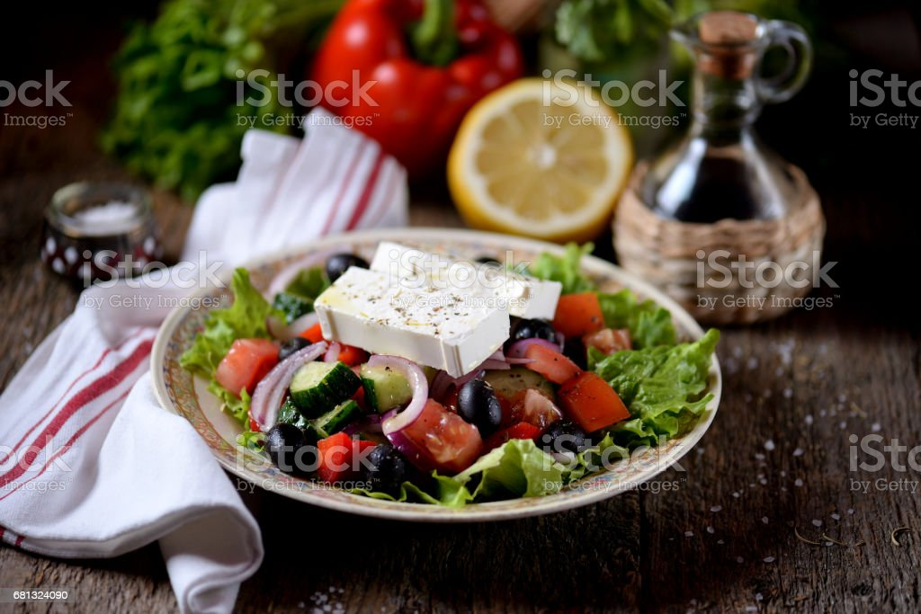 Classic Greek salad from tomatoes, cucumbers, red pepper, onion with olives, oregano and feta cheese. royalty-free stock photo