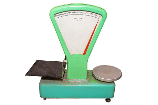 Classic, green weight scale, isolated on a white background with a clipping path.