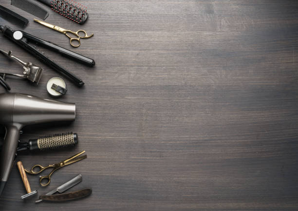 Classic grooming and hairdressing tools on wooden background. stock photo