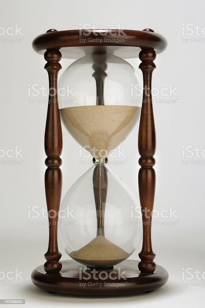 Classic Hardwood Pillar Hourglass; Stock Image Symbolic of Time royalty-free stock photo