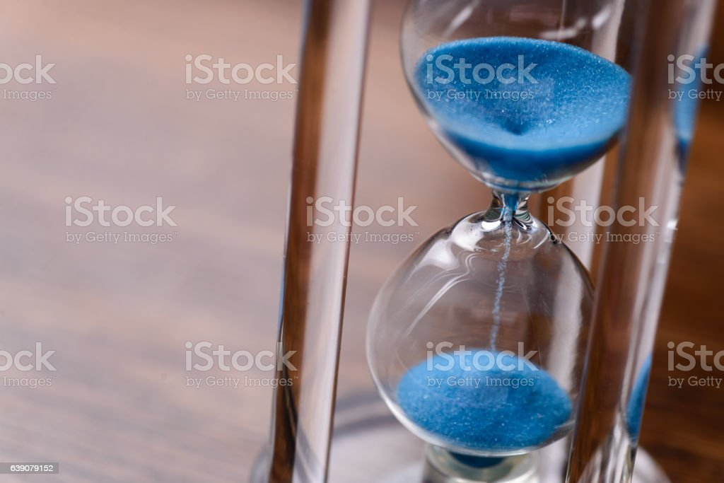 Classic hourglass with blue sand pouring – Foto