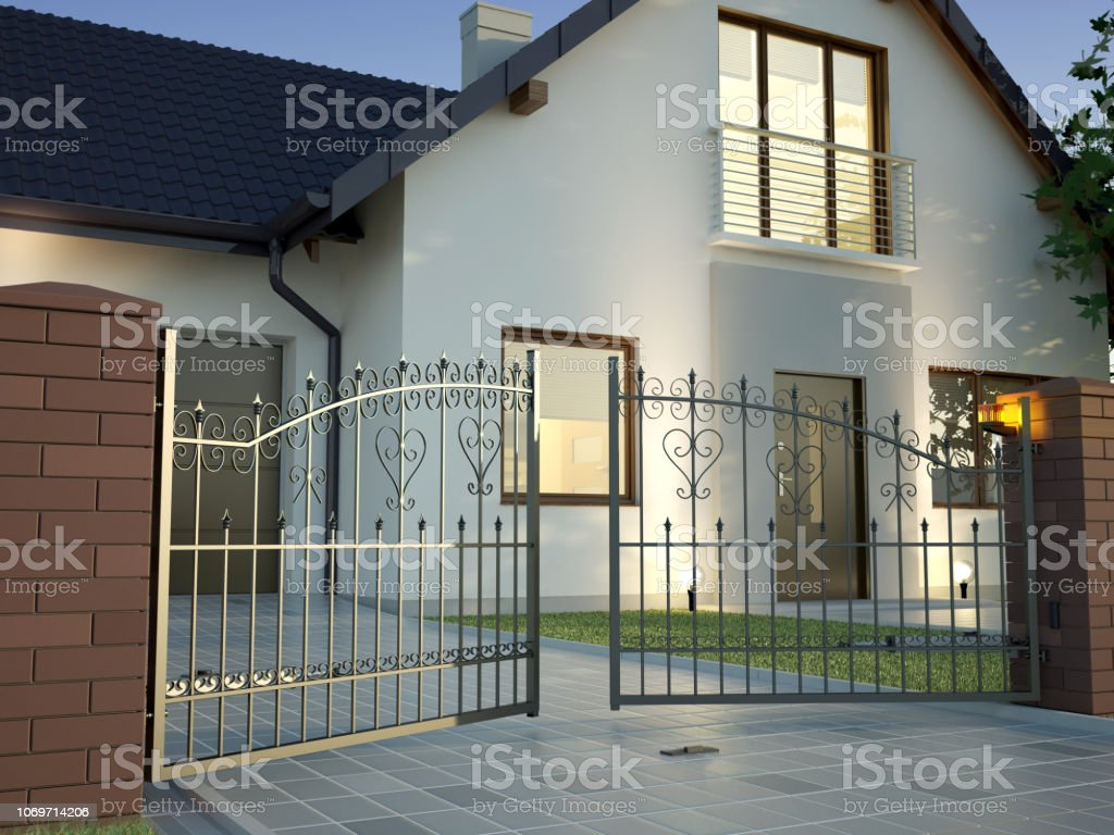 Classic Iron Gate and house royalty-free stock photo