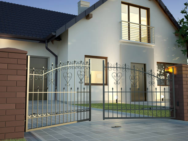 Classic Iron Gate and house stock photo
