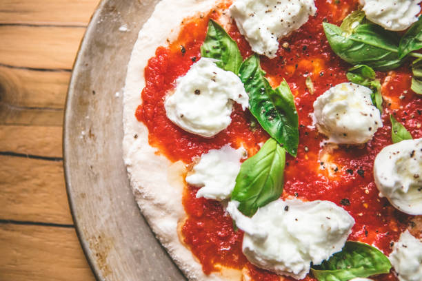 Classic Italian Pizza With Homemade Tomato Sauce, Basil And Mozzarella stock photo