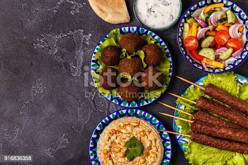 istock Classic kebabs, falafel and hummus on the plates. 916836358
