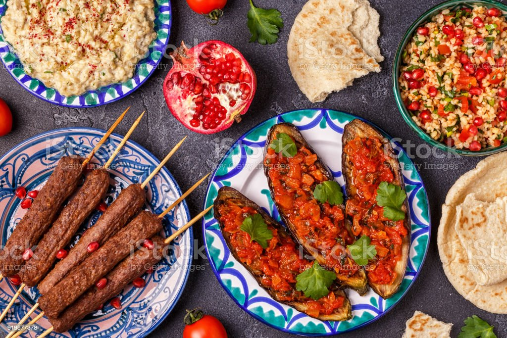 Classic kebabs, tabbouleh salad, baba ganush and baked eggplant with sauce. stock photo