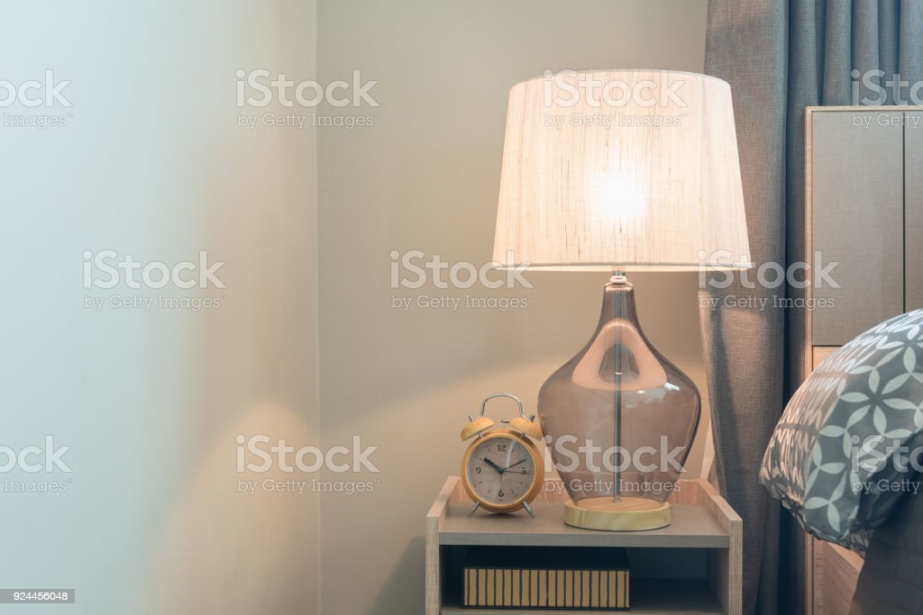classic lamp on wooden table side stock photo