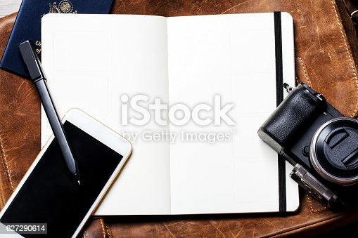 istock Classic Leather Briefcase with Open Notebook on Wood 627290614