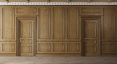 istock Classic luxury empty room with wooden boiserie on the wall. 1221955237