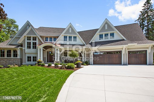 Three car garage and beautifully landscaped yard of showcase home