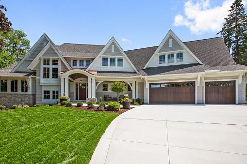 Three car garage and beautifully landscaped yard of showcase home
