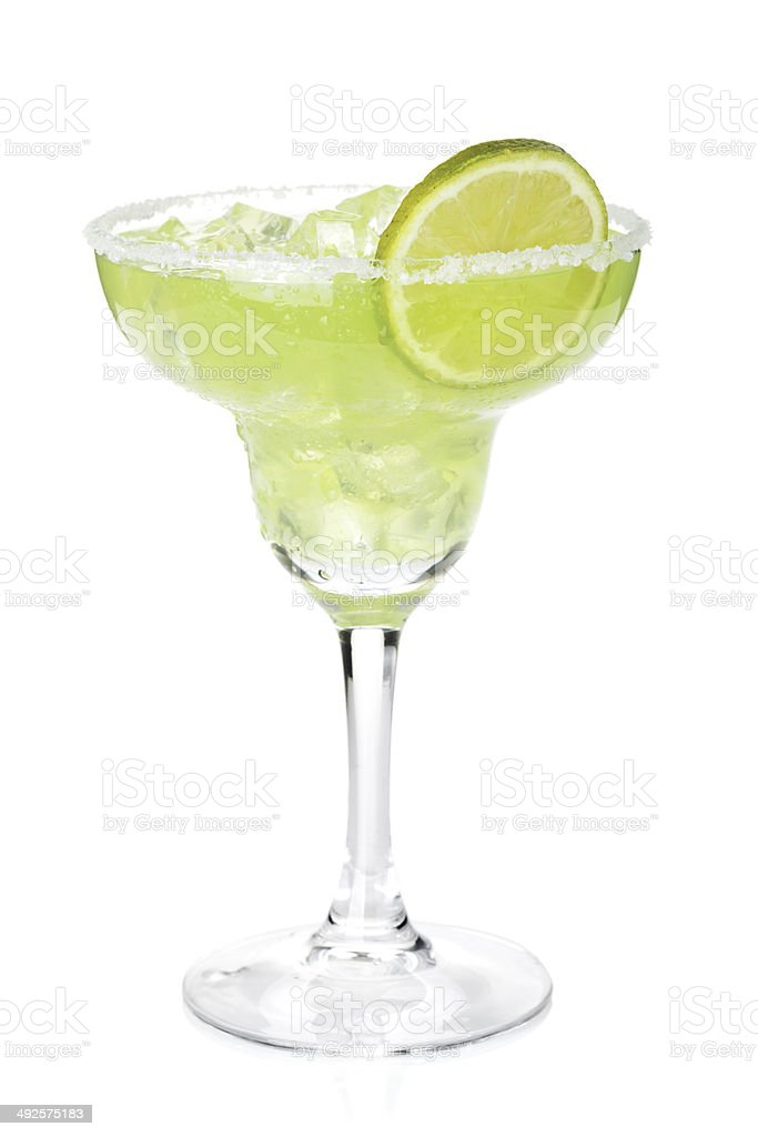 Classic margarita cocktail with lime slice and salty rim stock photo