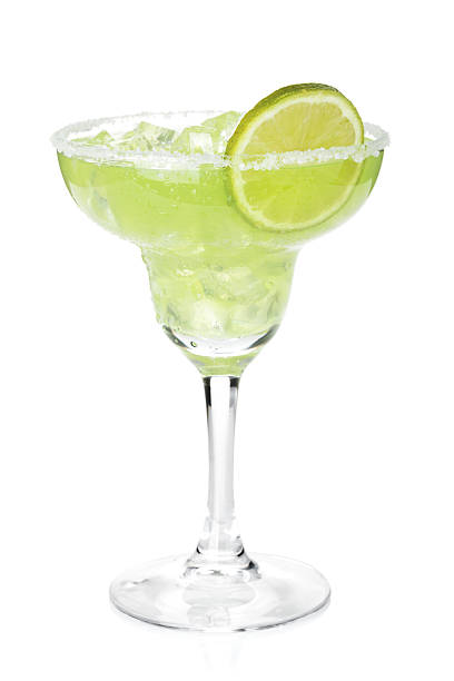 Classic margarita cocktail with lime slice and salty rim Classic margarita cocktail with lime slice and salty rim. Isolated on white background margarita stock pictures, royalty-free photos & images