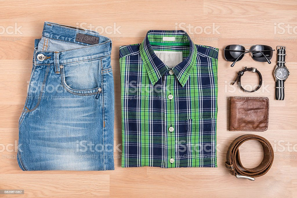 Classic men casual outfits fashionable with accessories on wooden...