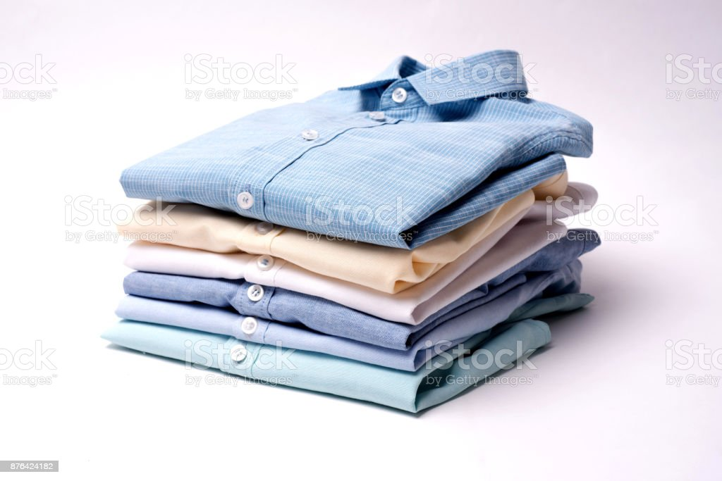 Classic men's shirts stacked on white background royalty-free stock photo