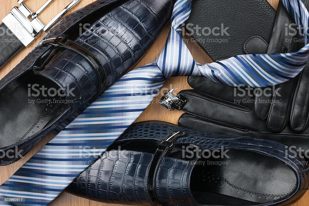 Classic men's shoes, tie, cufflinks, gloves, belt, purse on the stock photo