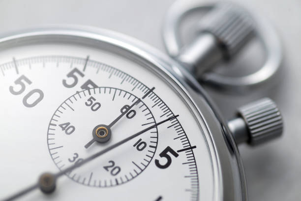 Classic metallic chrome mechanical analog stopwatch Classic metallic chrome mechanical analog stopwatch. Close up shot. countdown stock pictures, royalty-free photos & images