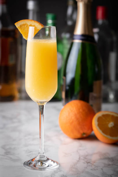 classic mimosa on marble background stock photo