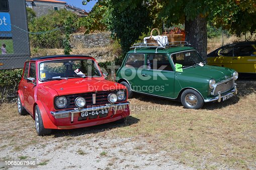 Caramulo, Portugal – September, 7, 2013: Classic Mini 1275 GT and Mini on the parking during the meeting of classic cars friends. The first Mini is cult car today.