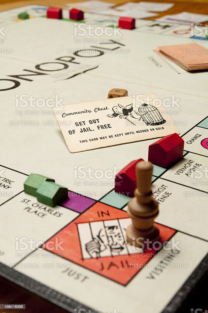 Classic Monopoly Game With Wood Pieces royalty-free stock photo