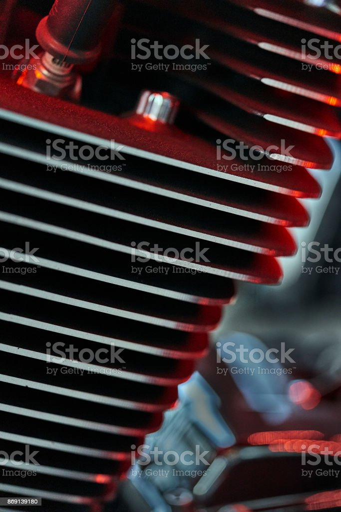 classic motorcycle engine part glowing red stock photo