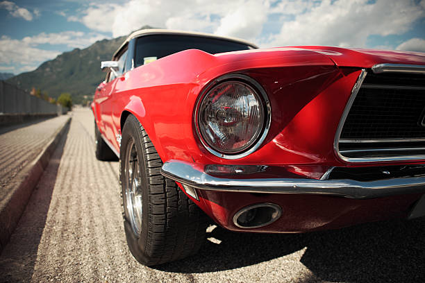 Classic Muscle Car American muscle car convertible on the road, cropped image sports car stock pictures, royalty-free photos & images