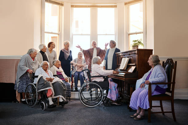 classic music for classic ladies - full length of senior people singing together against white stock photos and pictures