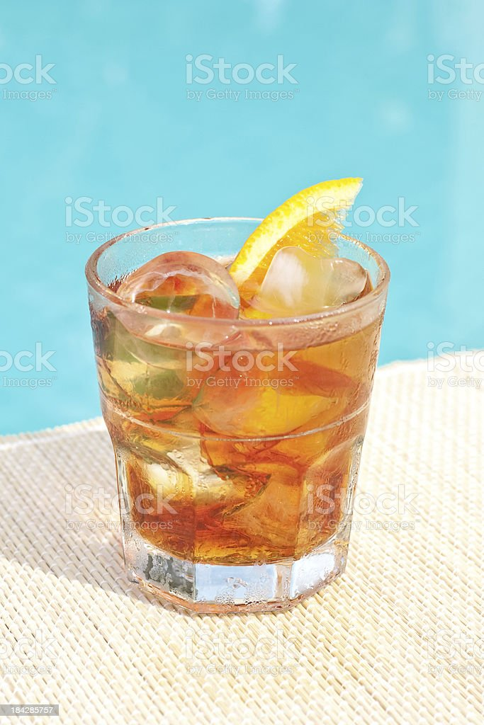 Classic Negroni cocktail near waterpool on the mat stock photo