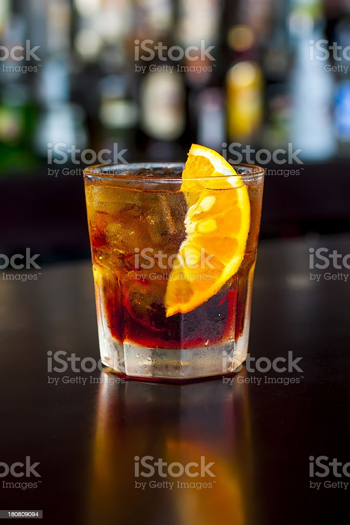Classic Negroni cocktail on the  black bar table stock photo