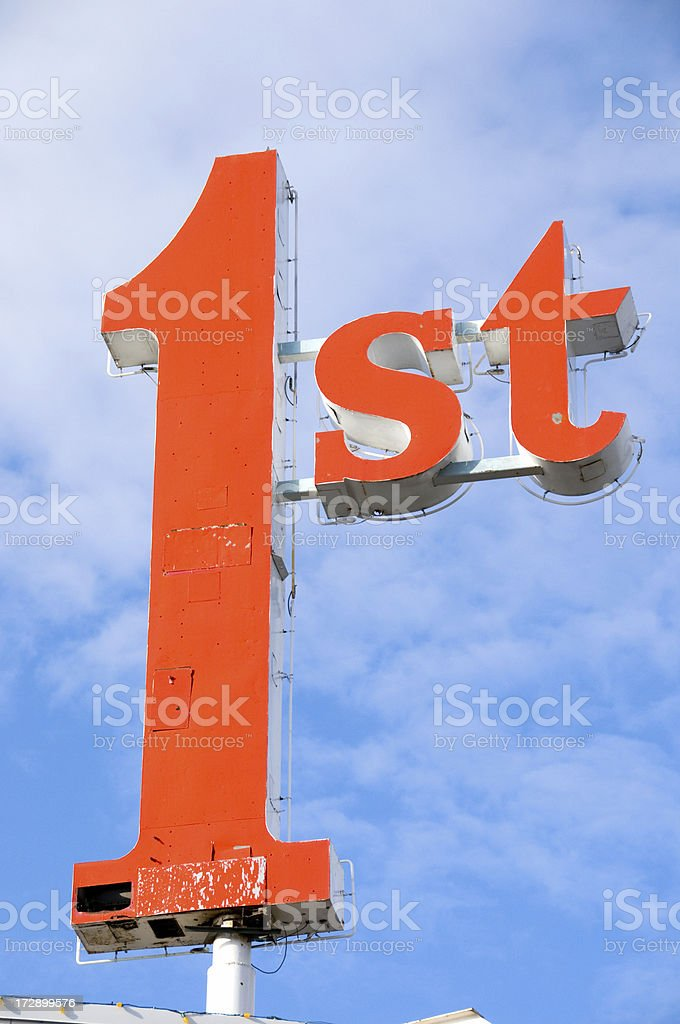 Classic Neon First (1st) Sign against a Perfect Blue Sky royalty-free stock photo