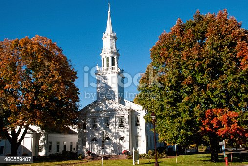 A classic white church and steeple in the autumn in Avon Connecticut.