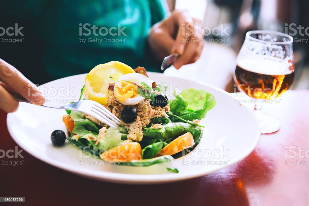 Classic Nicoise Salad or Tuna Salad and glass of Draft Beer. - foto de acervo