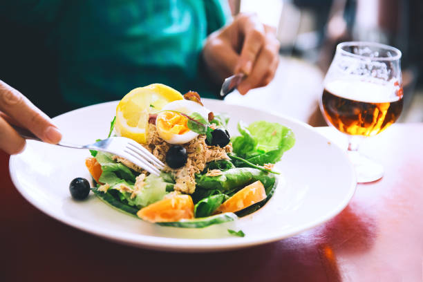 Classic Nicoise Salad or Tuna Salad and glass of Draft Beer. stock photo