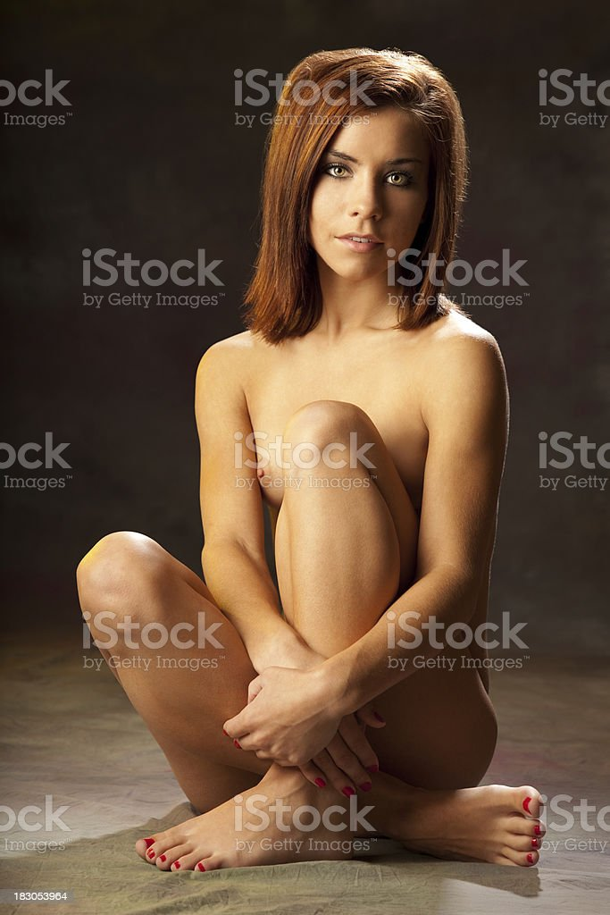 Classic Nude; Beautiful Young Woman Sitting royalty-free stock photo