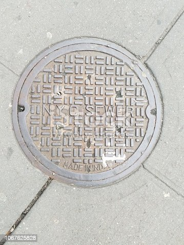 Classic N.Y.C. sewer steel manhole cover with pattern and Made in India stamp