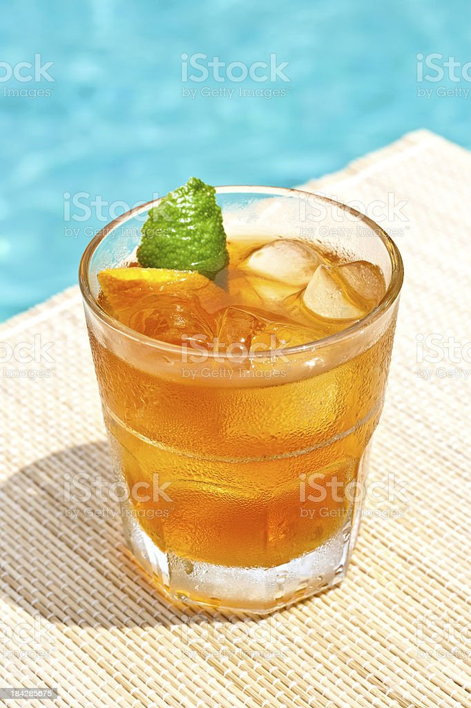 Classic Old Fashioned cocktail near waterpool on the mat stock photo