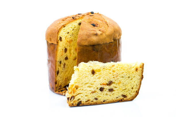 classic panettone with dried fruit ,traditional italian christmas cake on white background. in front a sliced part of cake. - panettone foto e immagini stock