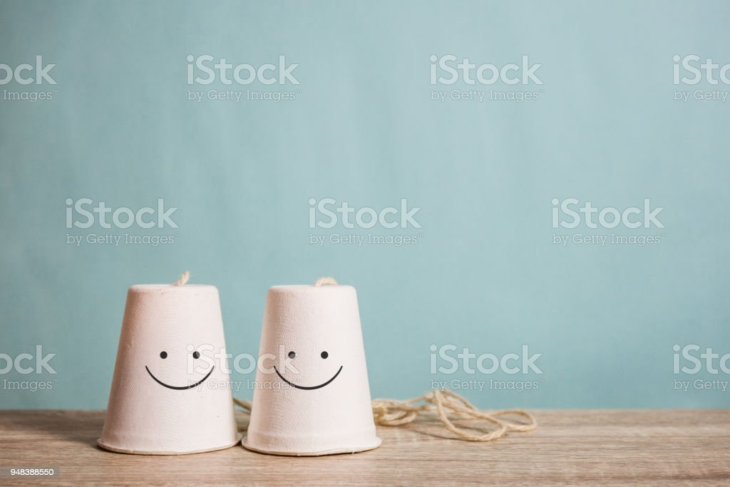 classic paper cup phone on wood background stock photo