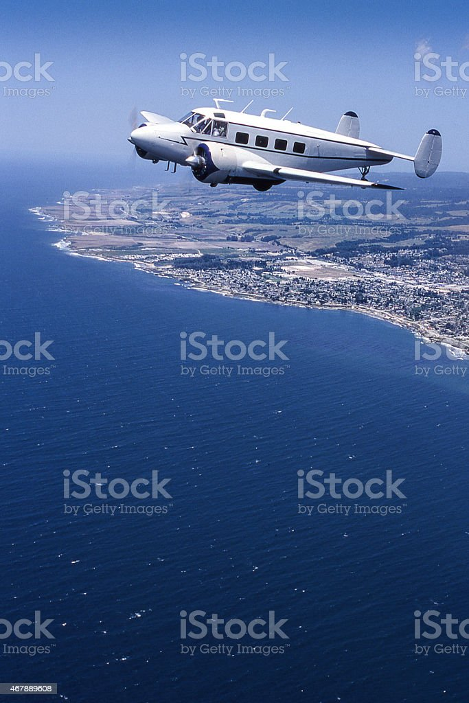 Classic Passenger Airplane in Flight Over Central Coast Californa stock photo