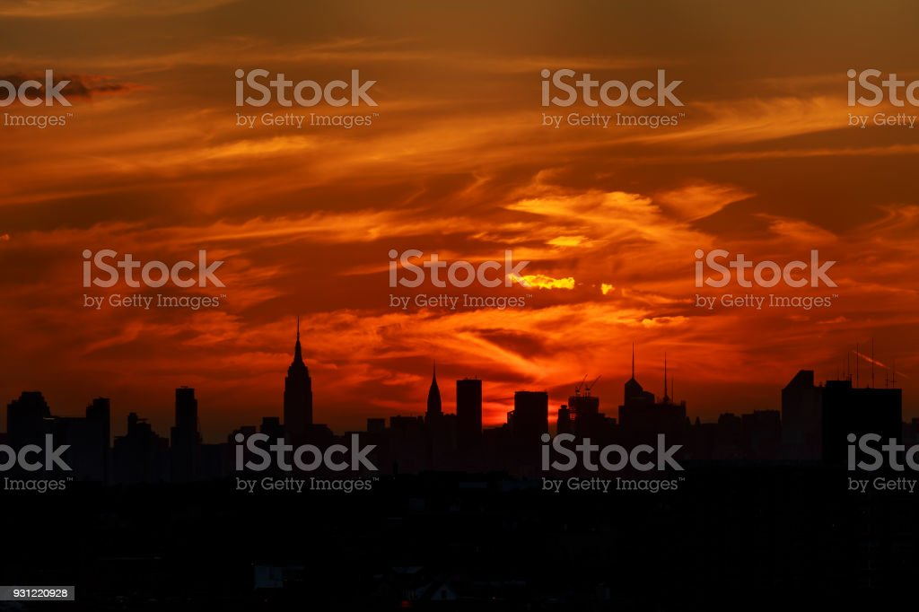 A classic photo of a scenic sunset with the skyscrapers of New York City stock photo