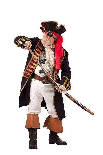 classic pirate frowning and drawing sword - swashbuckler stock photos and pictures