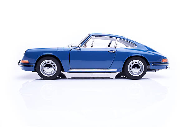 Classic Porsche 911 Model On White Beaconsfield, UK - October 7, 2015: A 1:18 scale model of a 1964 Porsche 911 made by Auto Art, sitting on a bright white base against a bright white background.  porsche stock pictures, royalty-free photos & images
