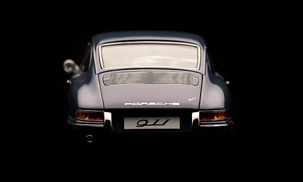 Classic Porsche 911 Model Rear View Beaconsfield, UK - February 22, 2016: A 1:18 scale model of a 1964 Porsche 911 made by Auto Art, set against a solid black background. Low key image of the back end of the car. porsche stock pictures, royalty-free photos & images