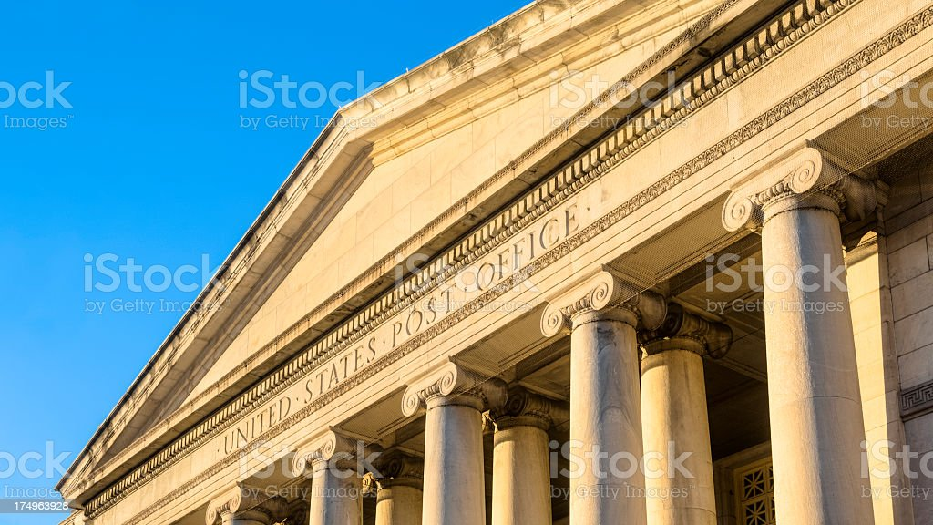 Classic Post Office Front Entrance under Sky of Blue royalty-free stock photo