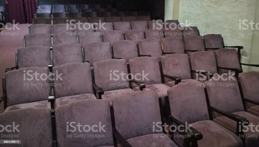 Classic purple theater seats in many rows stock photo