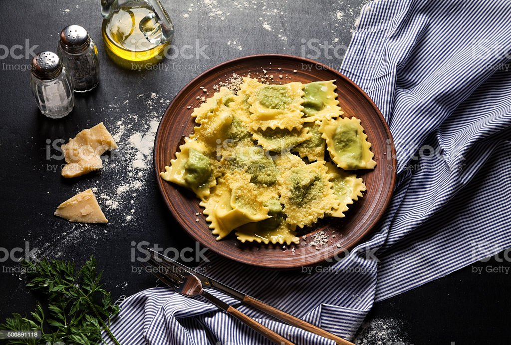 classic ravioli on a plate with cutlery. Italian dumplings. Heal stock photo