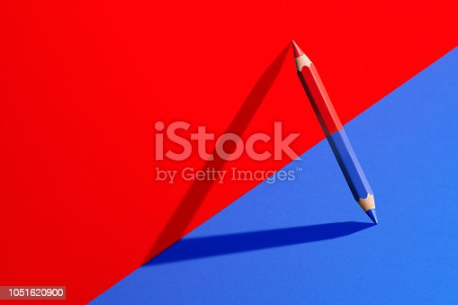 Classic red and blue checking pencil with shadow in red and blue corner.