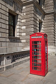 Classic and traditional red British telephone box in London, United Kingdom