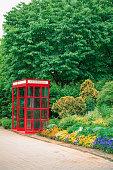 Classic red British telephone box in Park
