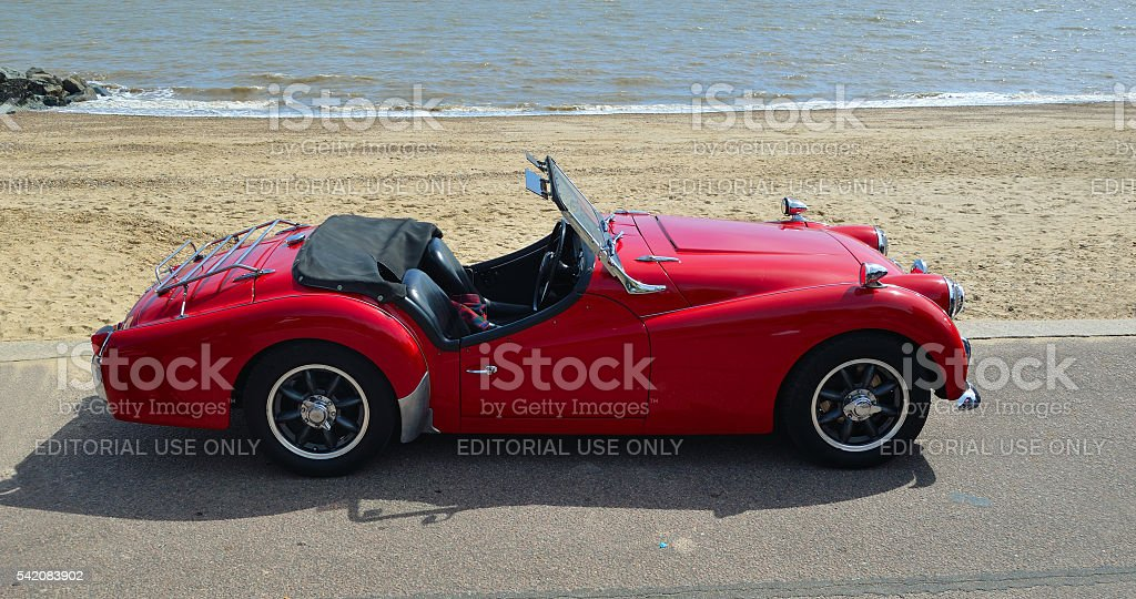 Classic Red MGA parked on seafront promenade. stock photo